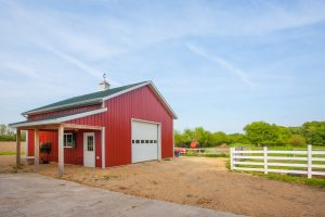 Red Classic Rib metal siding on a classic looking barn in Illinois